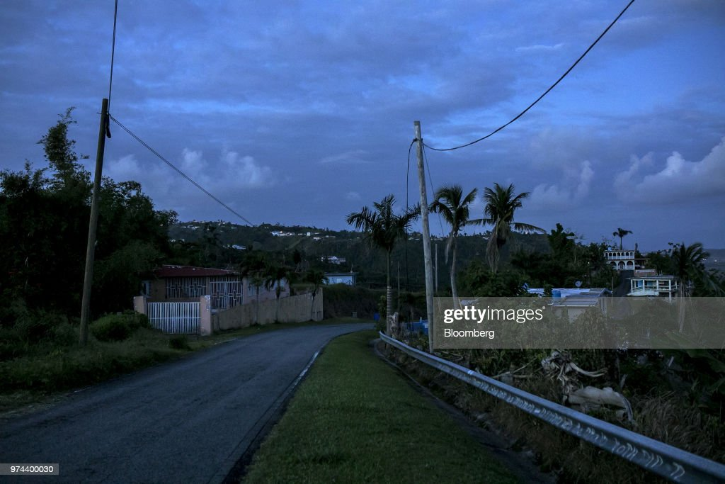 Homes without electricity since Hurricane Maria stand in the town of Jacanas, Yabucoa, Puerto Rico, on Friday, May 18, 2018. The bankrupt U.S. commonwealth's investment bankers last week started sounding out suitors for the eight-decade-old monopoly known asPrepa, whose rickety infrastructure was almost erased by Hurricane Maria in 2017. The halting efforts to repair the damage and improve the antiquated grid have been the central obstacle in recovery. Photographer: Xavier Garcia/Bloomberg via Getty Images