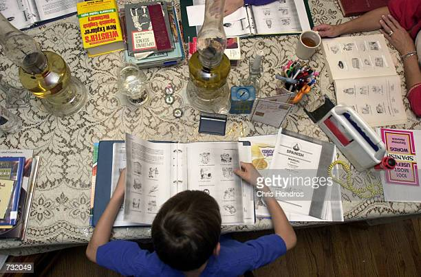Home-schooled child Andrew Sloggy looks over a Spanish notebook September 14, 2000 in Fayetteville, NC. His mother, Vivian Sloggy, has been...