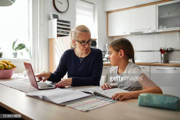 homeschooling - 9 years old girl finishing homework - 8 9 years stock pictures, royalty-free photos & images