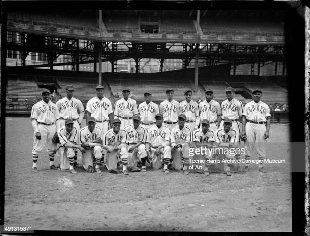Homestead Grays baseball team at Forbes Field Pittsburgh Pennsylvania 1945 Kneeling from left Dave Whatley Jud Wilson Matt Carlisle Frank 'Shorty'...