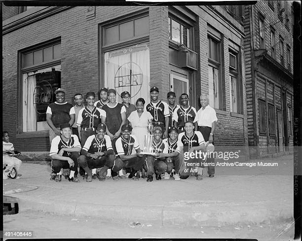 Homestead Tippers softball team posed in front of 600 Bar Homestead Pennsylvania August 1962 Front row from left Mike Jackson Lawrence Thompson...