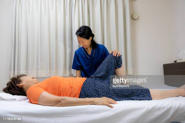 home-visit nursing care - body massage japan stock pictures, royalty-free photos & images