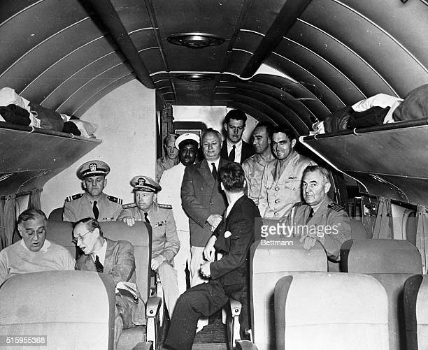 Homeward bound from the Casablanca Conference of 1943 President Roosevelt is shown in animated conference with Harry Hopkins Sitting directly behind...