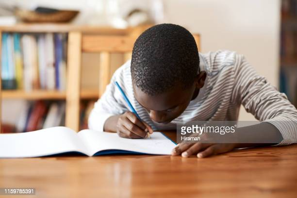 homework encourages them to use their time well - workbook stock pictures, royalty-free photos & images