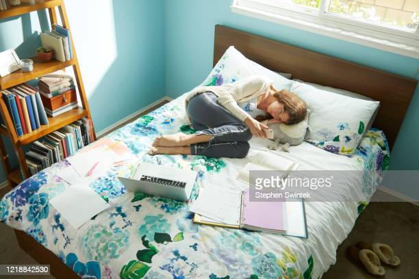 homework in bed - taking a break - sadgirl stock pictures, royalty-free photos & images