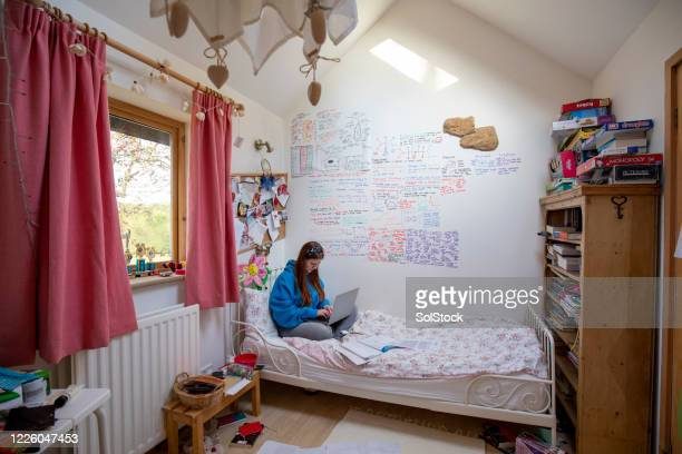 homework in quarantine - bedroom stock pictures, royalty-free photos & images