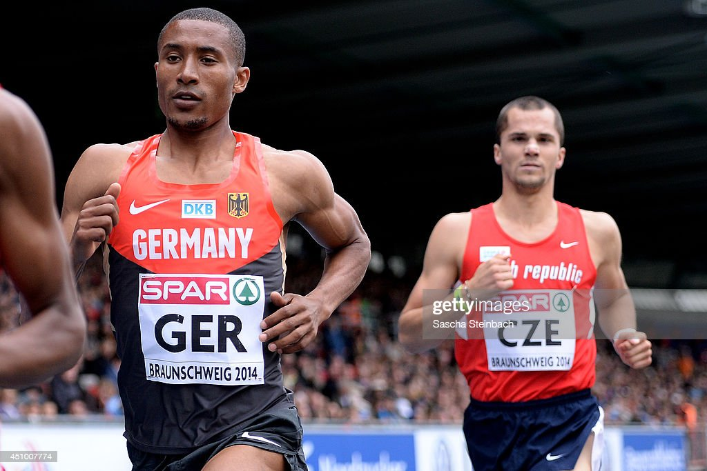 Homiyu Tesfaye of Germany and Jakub Holusa of Czech Republic compete in the Men's 1500m during first day of the European Athletics Team Championship at Eintracht Stadium on June 21, 2014 in Braunschweig, Germany.