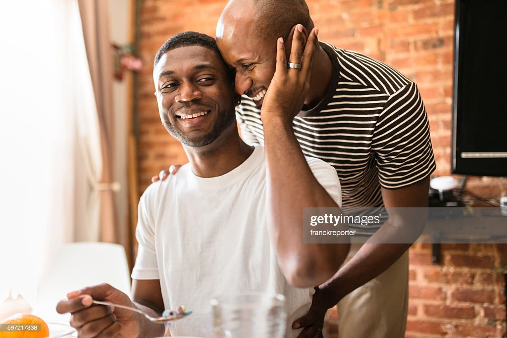 homosexual couple doing breakfast on the kitchen togetherness : Stock Photo