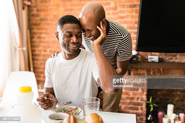 homosexual couple doing breakfast on the kitchen togetherness - coppia omosessuale foto e immagini stock