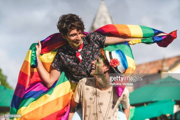 homosexual couple flag with rainbow flag - gay rights stock pictures, royalty-free photos & images
