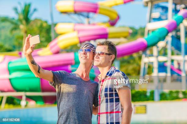 Homosexual couple having fun in waterpark