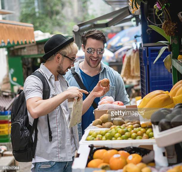 Homosexual couple in a food market in Hong Kong