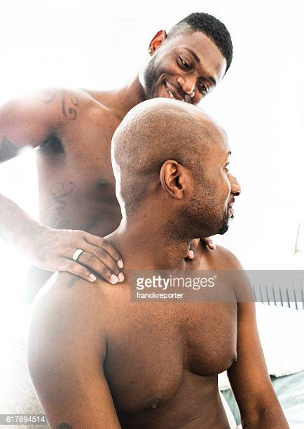 homosexual couple relaxing togetherness and sharing a massage - massage tantrique photos et images de collection