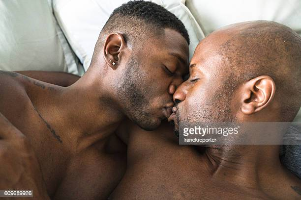 homosexual couple relaxing togetherness on the bed