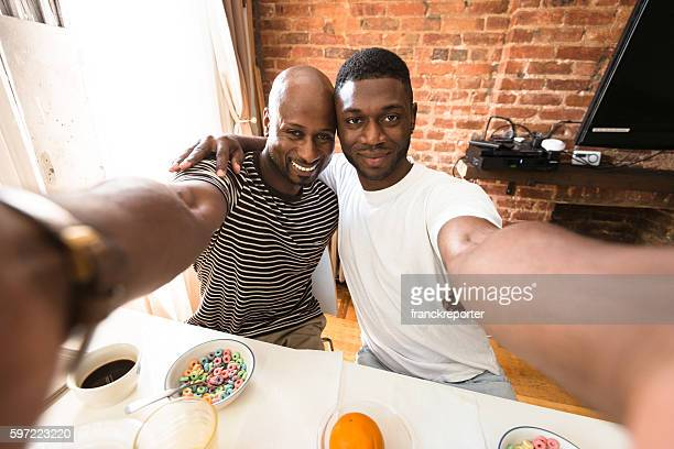homosexual couple take the selfie during the breakfast