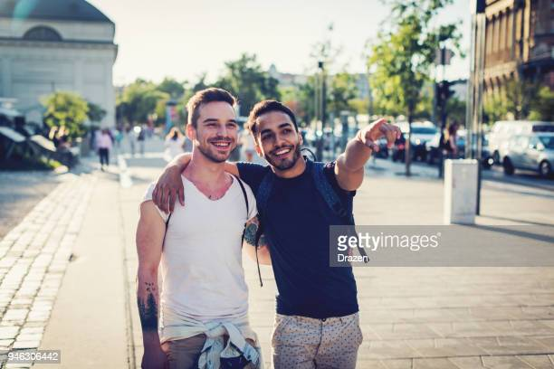 homosexual couple traveling around europe - gay person stock pictures, royalty-free photos & images