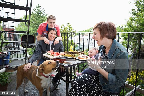 Homosexual couple with children having lunch