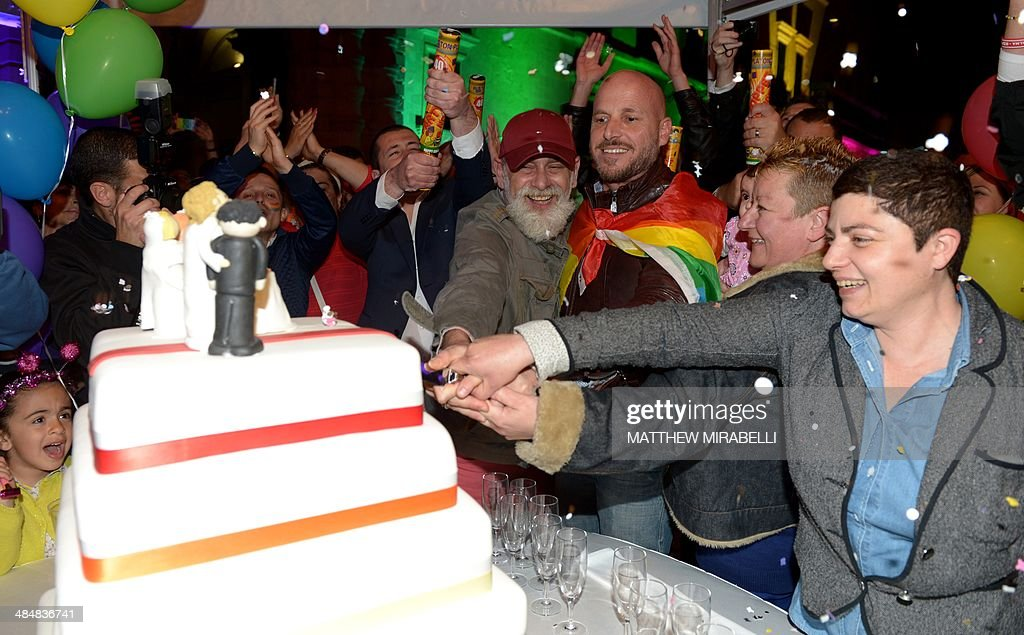 Homosexual Couples Cut A Symbolic Wedding Cake In Saint Georges