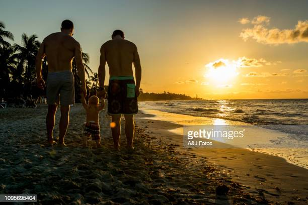 homosexual godparents and their young nephew - responsibility stock pictures, royalty-free photos & images