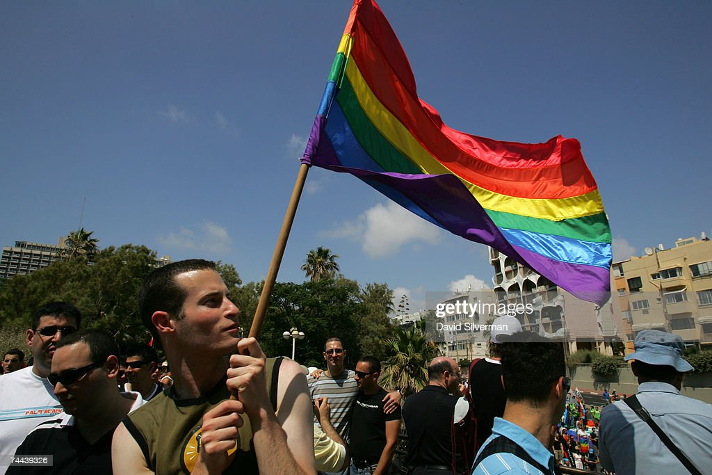 A homosexual Israeli man waves a rainbow flag during the annual Gay Pride rally, on June 8, 2007 Tel Aviv, Israel's most cosmopolitan city. Thousands of alternative lifestyle Israelis took advantage of the mild summer weather to celebrate sexual freedom amidst calls from Jewish, Muslim and Christian religious leaders to ban a similar rally in Jerusalem later this month.