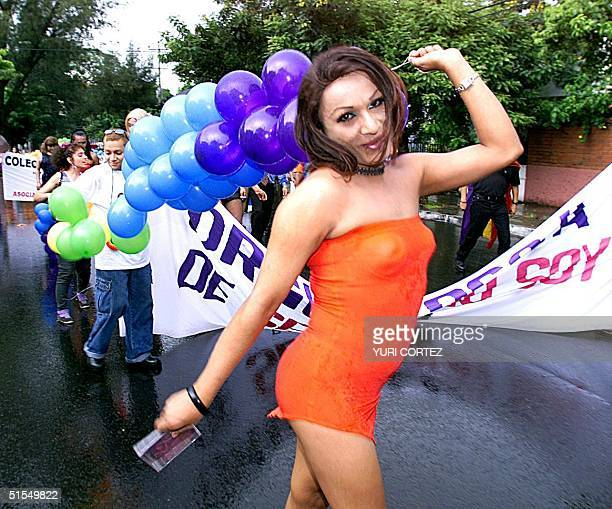 A homosexual participates in a march commemorating International Gay Pride Day 24 June 2000 organized by the group Between Friends which was formed...
