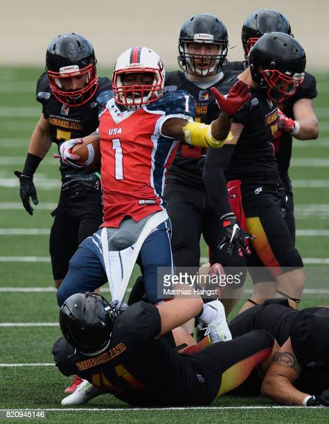 Homri Kerim of Germany tears down the trousers of Deante Battle of the United States during the Invitation Sports American Football match between the...