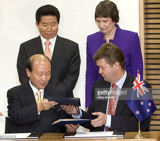 Hon David Culiffe Minister of Communications with Mr Rho Junhyong Korean Minister of Information and Communication sign a partnership agreement with...