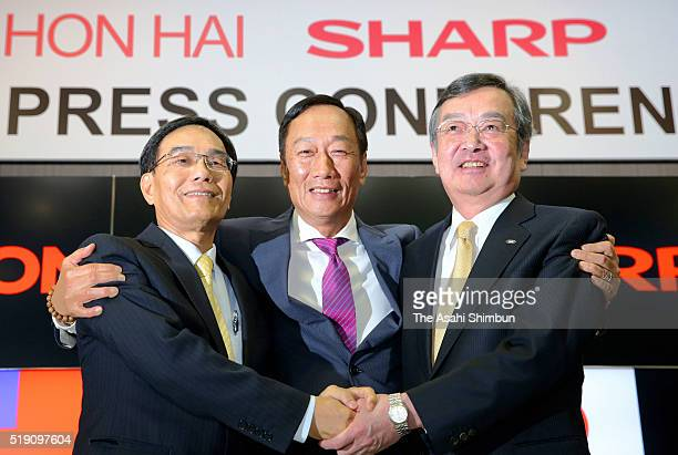 Hon Hai Precision Industry chairman Terry Gou Vice President Tai Jengwu and Sharp President Kozo Takahashi shake hands during the signing ceremony on...