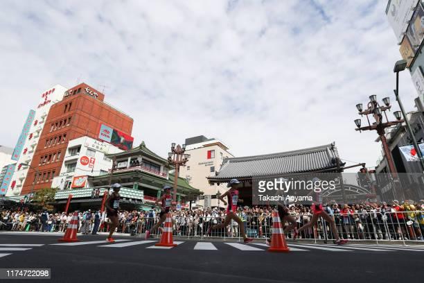 Honami Maeda, Yuka Ando, Rei Ohara, Ayuko Suzuki and Kayoko Fukushi pass the Kaminarimon at Sensoji Temple during the Marathon Grand Championships,...
