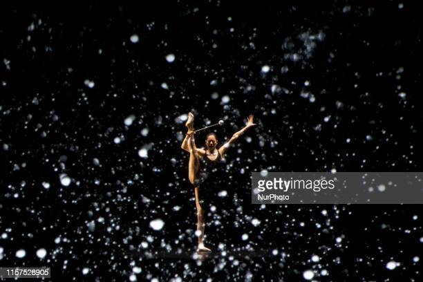 Honami Tsuboi of Japan performs with Panasonic's realtime tracking and projection mapping compatible projector during Tokyo 2020 Olympic Games...