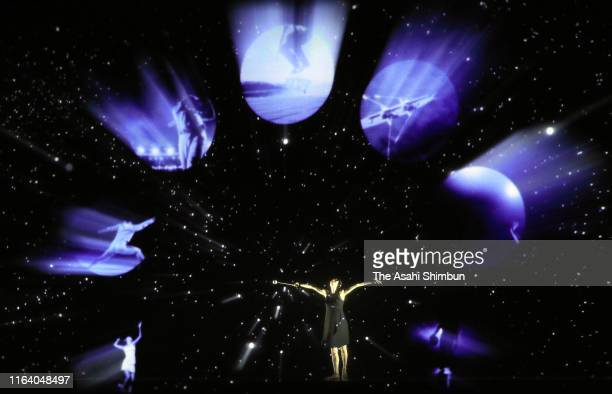 Honami Tsuboi performs with Panasonic's realtime tracking and projection mapping compatible projector during the 'One Year To Go' ceremony on the day...