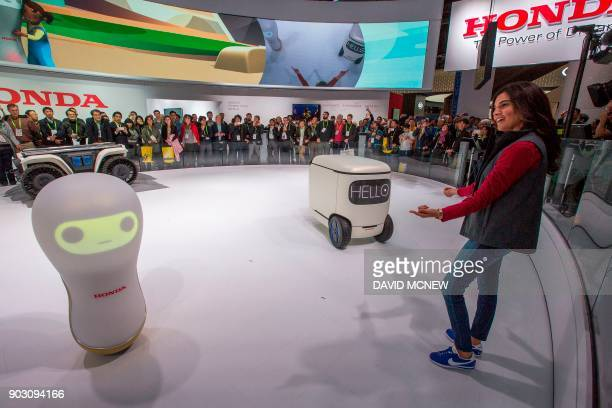 Honda 3EA18 and 3C18 concept robots are shown at CES in Las Vegas Nevada January 9 2018 / AFP PHOTO / DAVID MCNEW