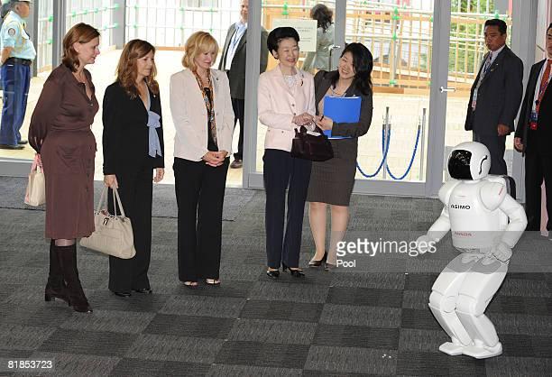 Honda Asimo robot greats Sarah Brown, wife of United Kingdom Prime Minister Gordon Brown , Margarida Sousa Uva , wife of European Union President...