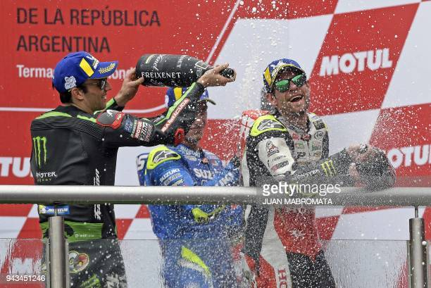 Honda biker Cal Crutchlow of Great Britain Yamaha biker Johann Zarco of France and Suzuki biker Alex Rins of Spain celebrate their first second and...