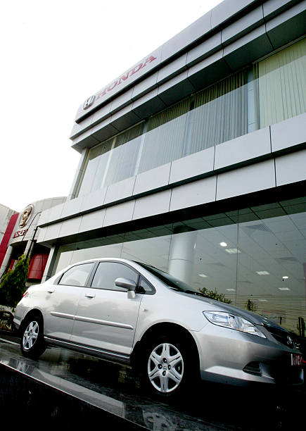 A honda city car is displayed outside the 39 ring road honda for Value car motor city