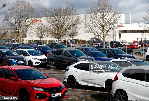 Honda Civic and Jazz vehicles are pictured parked in a car park outside the Honda manufacturing plant in Swindon, southwest England on February 19,...
