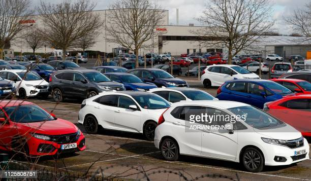 Honda Civic and Jazz vehicles are pictured parked in a car park outside the Honda manufacturing plant in Swindon southwest England on February 19...