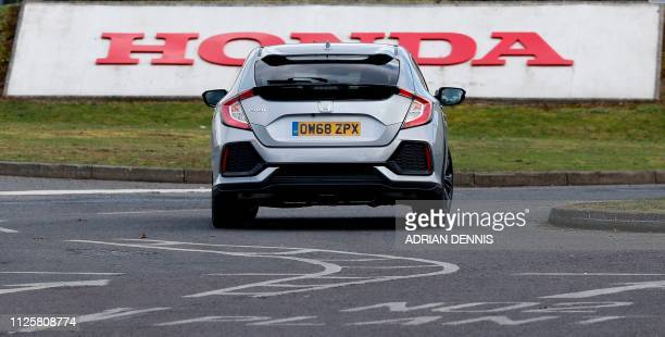 A Honda Civic car is driven at the Honda manufacturing plant in Swindon southwest England on February 19 2019 Honda will shut its UK plant with the...