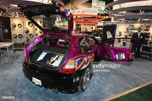 Honda Civic customized with a 37 inch plasma television in the hatchback compartment and smaller video displays in the doors and on the dashboard is...