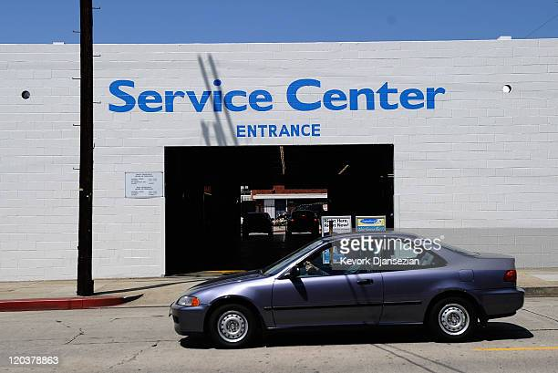 Honda Civic drives past the service center of Honda of Hollywood dealership on August 5, 2011 in Los Angeles, California. Honda Motor Co. Is...