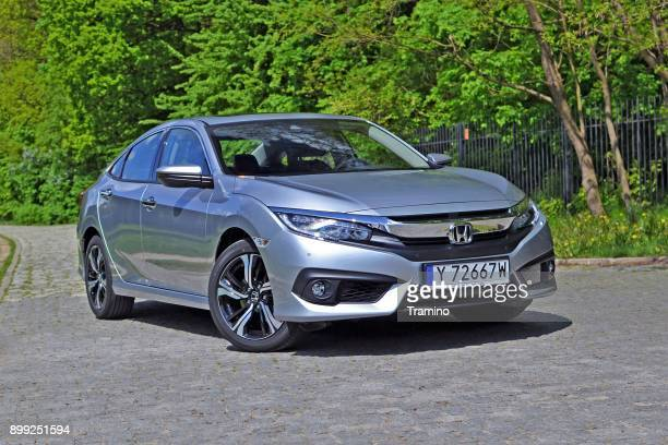 honda civic sedan on the street - compact car stock photos and pictures