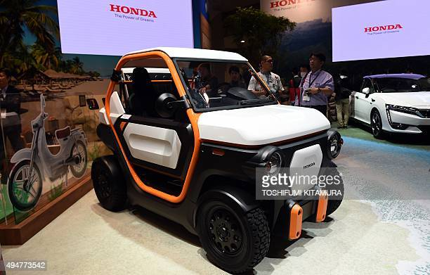 Honda displays its MBEV Concept vehicle at the Tokyo Motor Show in Tokyo on October 29 2015 The biennial motor show's 44th edition which runs until...
