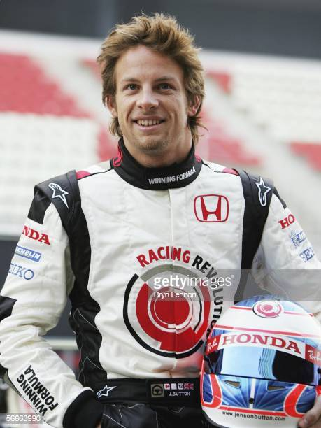 Honda driver Jenson Button of Great Britain poses during a photocall for the new Honda RA106 F1 car at the Circuito de Catalunya on January 25 in...