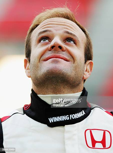Honda driver Rubens Barrichello of Brazil poses during a photocall for the new Honda RA106 F1 car at the Circuito de Catalunya on January 25 in...