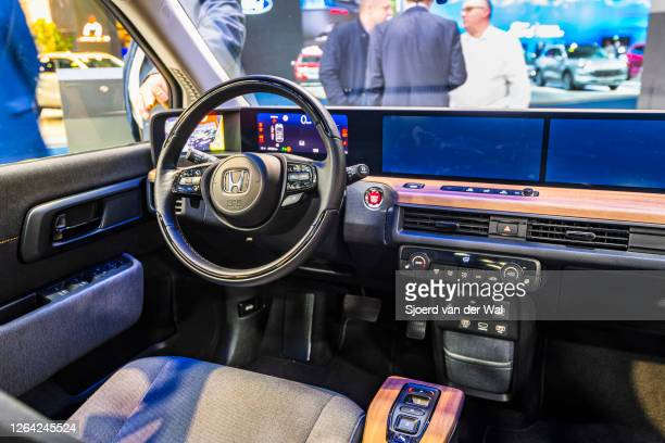 Honda e all electric compact car dashboard on display at Brussels Expo on January 9, 2020 in Brussels, Belgium. The Honda e is fitted with an...