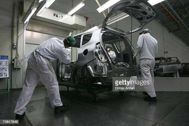 Honda employees work on the production line at the Honda factory on Thursday June 21 2007 in Karawang West Java Indonesia The former CEO of PT Honda...
