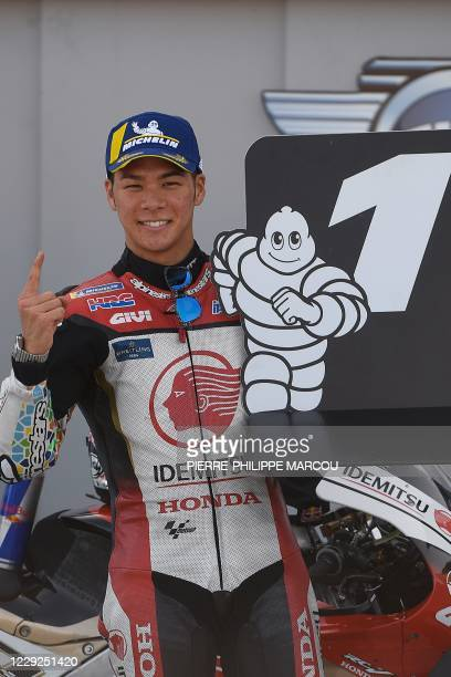 Honda IDEMITSU's Japanese rider Takaaki Nakagami celebrates after securing the pole position for the MotoGP Grand Prix of Teruel at the Motorland...