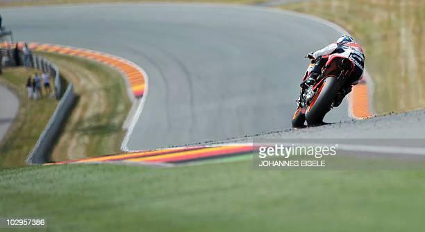 Honda MotoGP rider Dani Pedrosa of Spain steers his bike to win the race of the Moto Grand Prix of Germany at Sachsenring Circuit on July 18 2010 in...