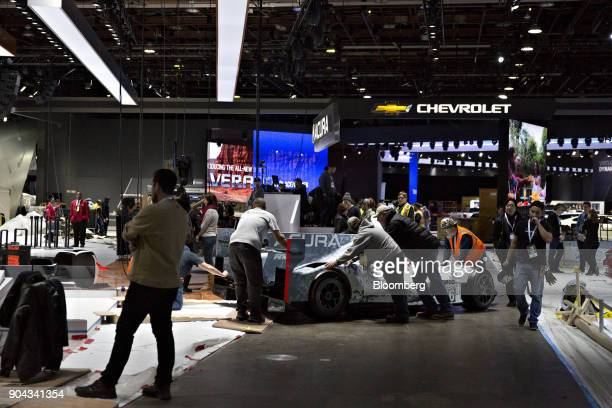 A Honda Motor Co Acura ARX05 race car is rolled into position ahead of the 2018 North American International Auto Show in Detroit Michigan US on...