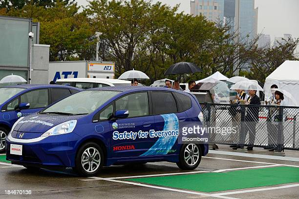 A Honda Motor Co Fit electric vehicle equipped with an automatic parking system is demonstrated at the ITS Word Congress Tokyo 2013 in Tokyo Japan on...